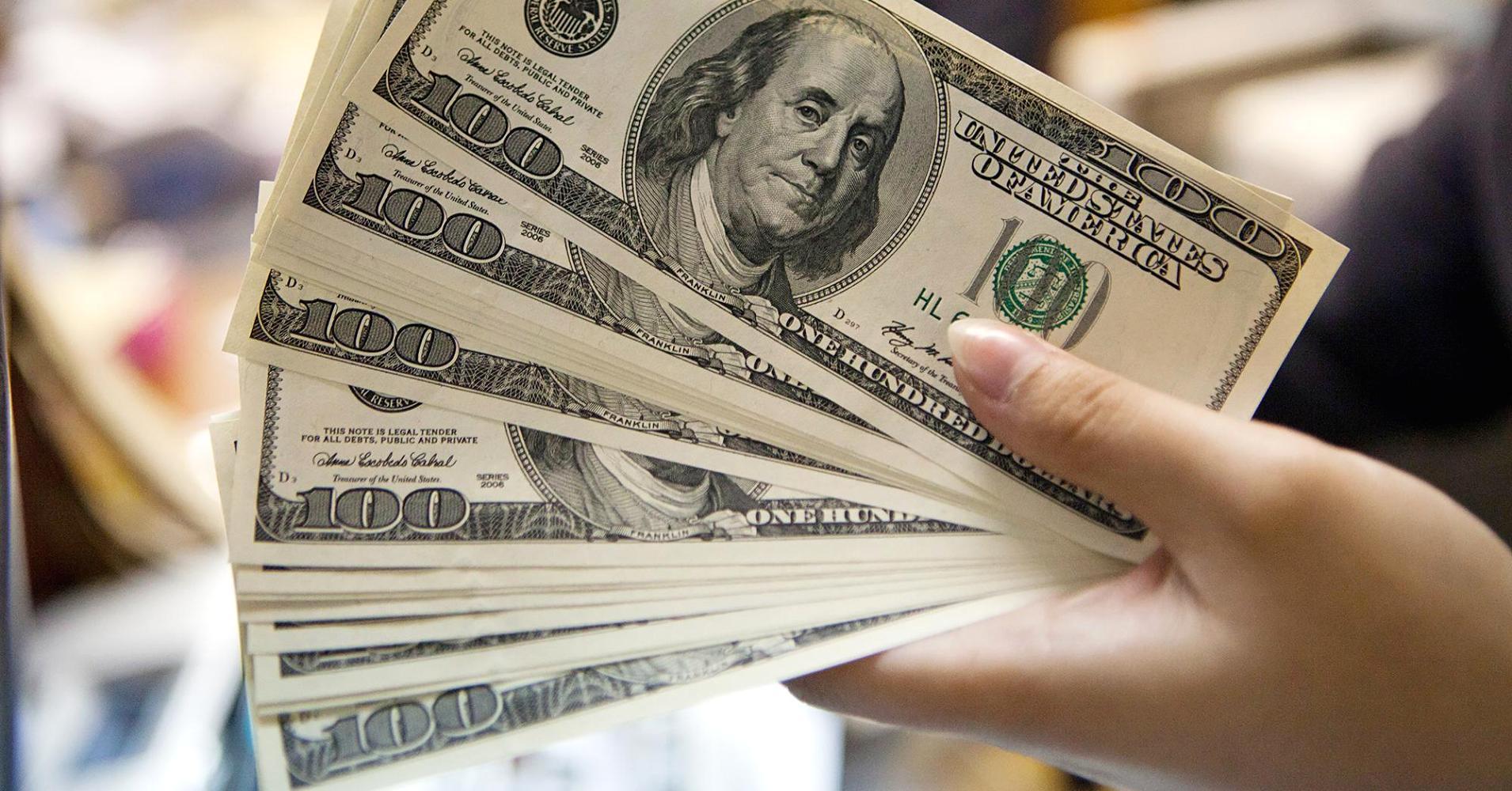 banknotes-100-us-dollars-1597474